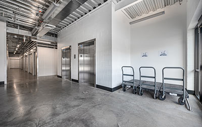 Convenient elevator access for upper level units & moving carts that may be used free of charge.